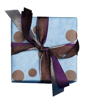 Gift wrapped in blue paper with metallic purple, brown and silver ribbons