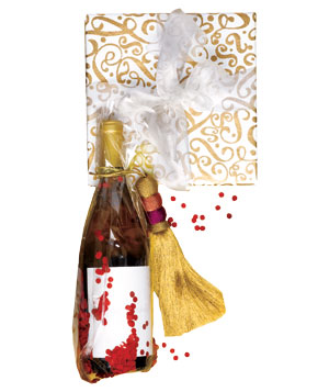 Gift wrapped with silvery ribbon and wine bottle wrapped with confetti and tassel