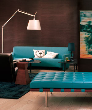 Dark brown living room with teal sofa