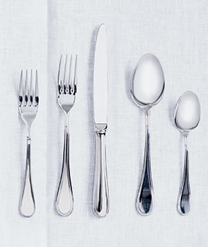 Utensils on a white cloth