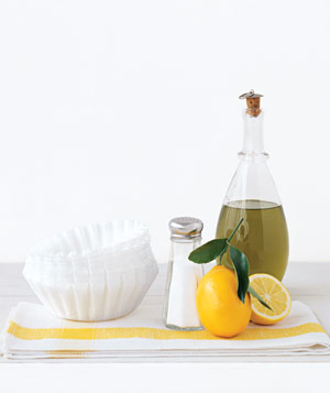 Olive oil, lemon, coffee filters and salt on a yellow napkin