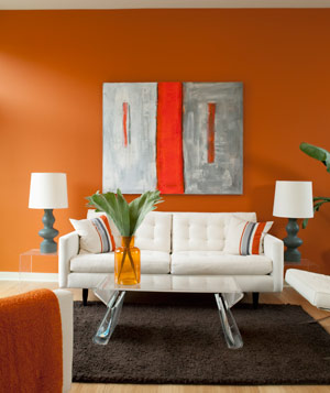 A modern graphic living room with orange walls