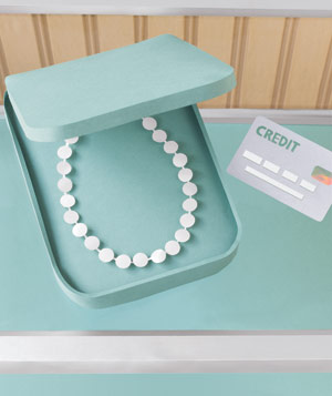 Paper construction of a pearl necklace in box by Matthew Sporzynski