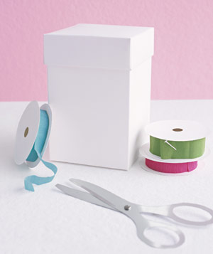 Paper construction of box with ribbon, scissors, and spool by Matthew Sporzynski