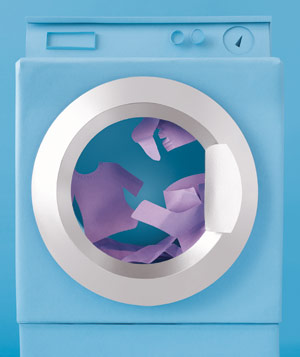 Paper construction of washing machine with clothes by Matthew Sporzynski