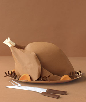 Paper construction of a Thanksgiving turkey on platter with serving pieces by Matthew Sporzynski