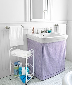 Pedestal sink covered with a fabric skirt