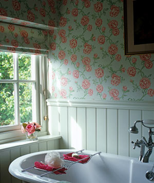 Bathroom with rose pattern wallpaper and coordinating blinds