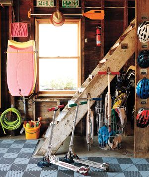 Surf board and scooters in garage