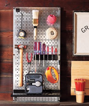 Tools and necessities on a pegboard in a garage