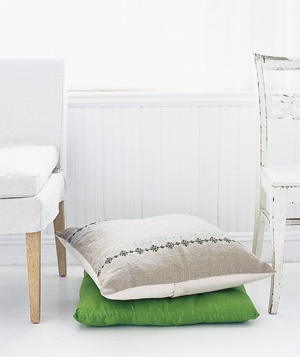 Pillows between chairs