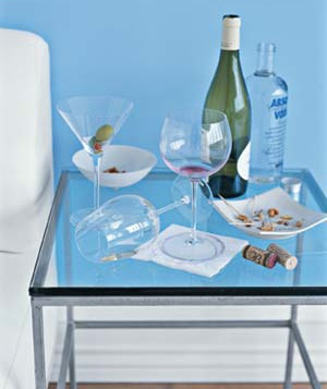 table with empty glasses, wine bottle and vodka
