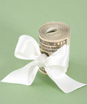 Roll of cash tied with white ribbon