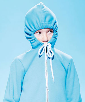 Boy with blue hood tied tightly around his face