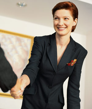 Buiness woman smiling and shaking hands