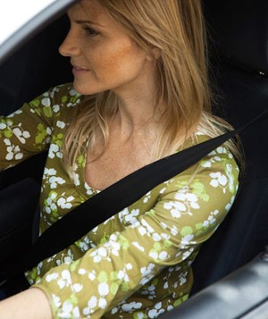Woman driving car wearing seatbelt