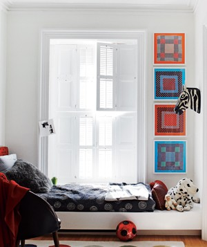 Bedroom with color fabric on walls