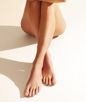 Models legs with laser hair removal