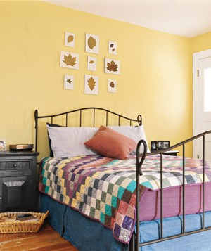 Yellow bedroom with quilt
