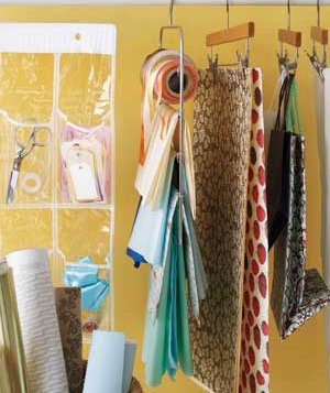 Wrapping paper stored on skirt hangers