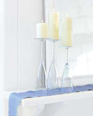 Candles perched on champagne flutes