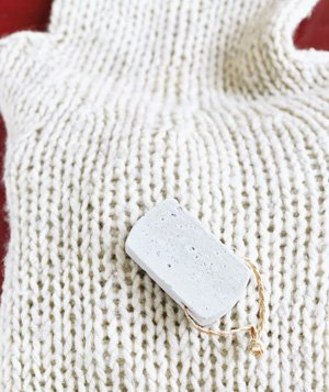 Pumice stone used to restore sweater