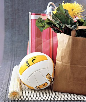 Soccer ball and grocery bags on a nonskid rug pad