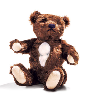Teddy bear opened up with cotton ball stuffing showing