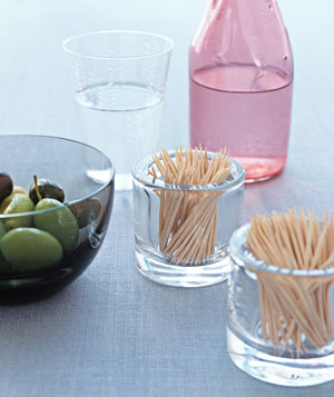 Votive candle holder as toothpick container