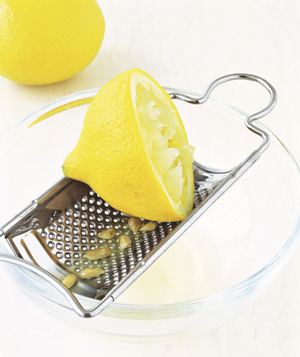 Grater used to strain citrus