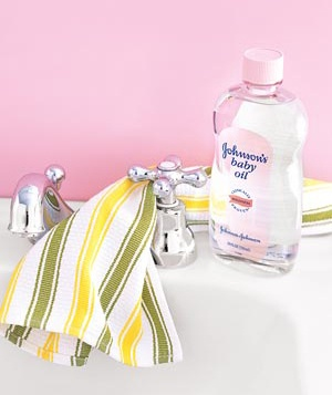 Baby oil, a cloth and faucet