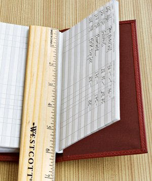 Checkbook used as ruler