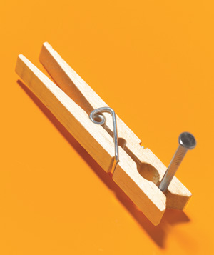Clothespin used to hold nails