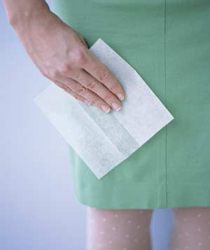 Woman using a dryer sheet to remove static cling