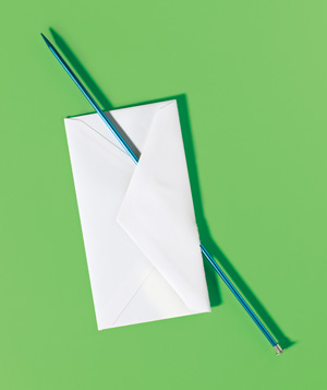 Knitting needle used to open an envelope