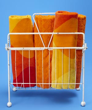 Metal magazine rack as towel holder