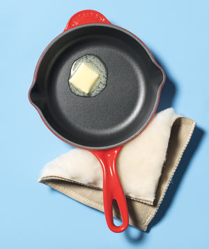 Ugg Boot pot holder with a frying pan with butter