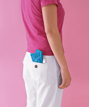 Folded plastic bag in back pocket of pants