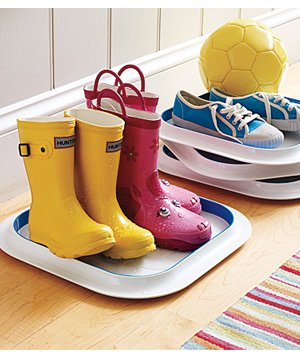 Plastic trays used to contain wet boots
