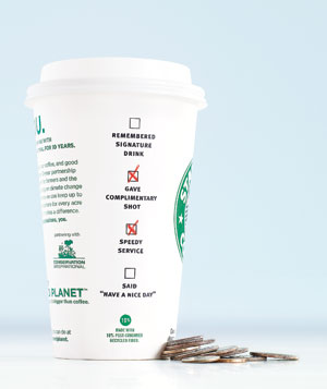 Starbucks cup and change