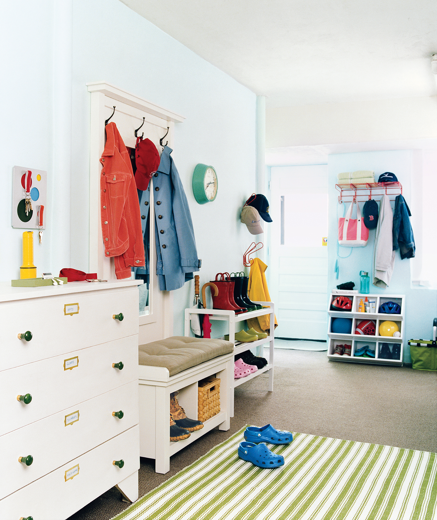 The focal point of this back entryway/mudroom? A spacious dresser specifically devoted to storing hats, gloves, scarves, and the like.