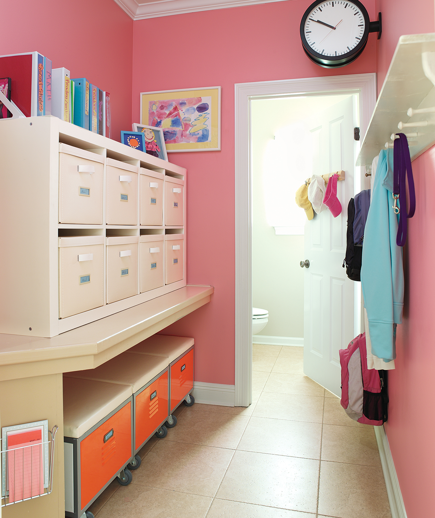 Even a narrow, high-traffic space can be kept orderly with smart storage, such as bins and pegs.