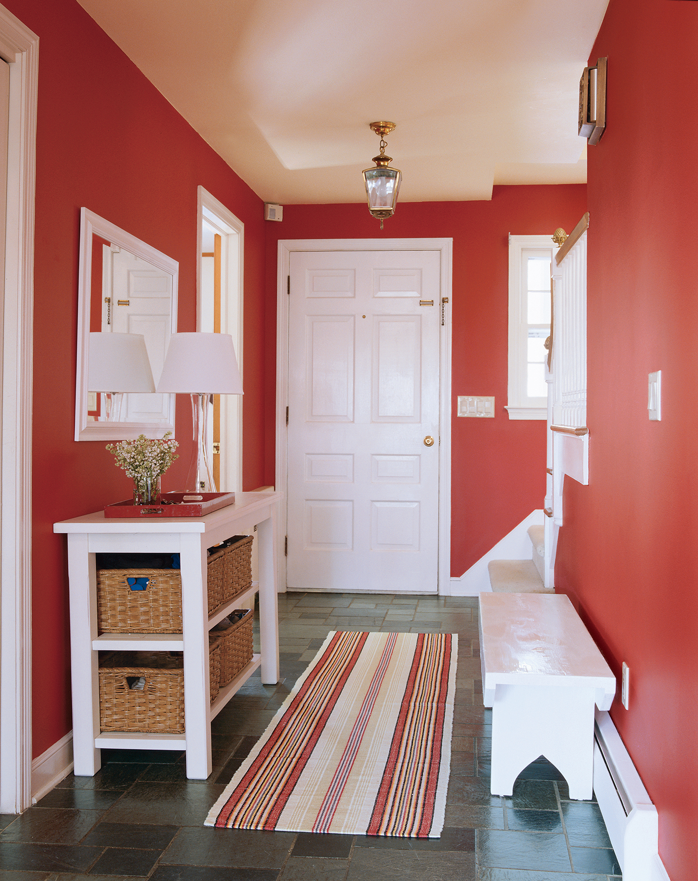 Define the space with a bold color like this red, which exudes a warm welcome.