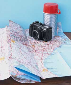Map with camera and thermos