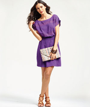 Model wearing BCBG purple dress and accessories