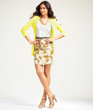 Model wearing pencil skirt yellow cardigan and accessories