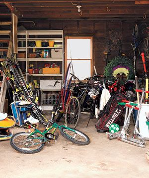 A messy garage filled with bikes and sports equipment