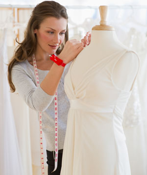 Seamstress in bridal shop