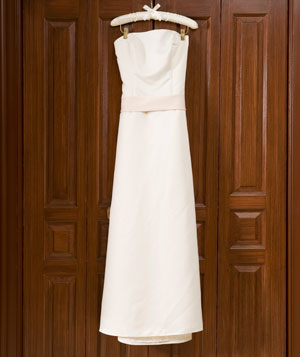 Wedding dress hanging on wardrobe