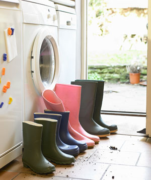 Pairs of rubber boots at backdoor